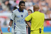 Brandao of Bastia is shown a yellow card by referee Amaury Delerue during the French Ligue 1 match between Paris Saint Germain FC and SC Bastia at...