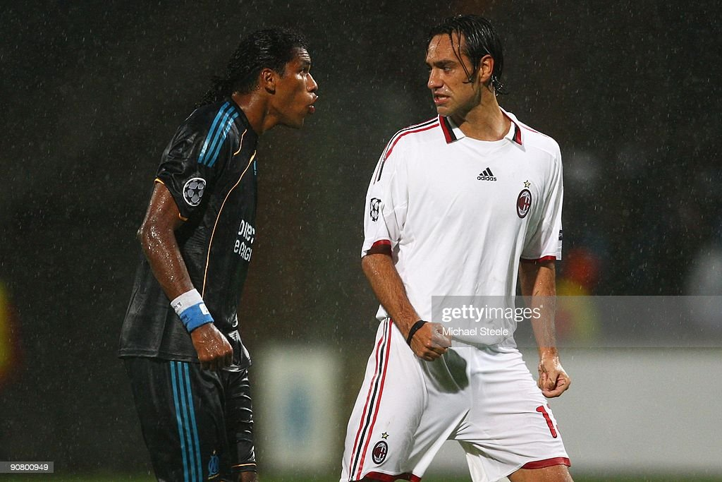 Brandao (L) of Marseille squares up to <a gi-track='captionPersonalityLinkClicked' href=/galleries/search?phrase=Alessandro+Nesta&family=editorial&specificpeople=213983 ng-click='$event.stopPropagation()'>Alessandro Nesta</a> of Milan during the UEFA Champions League Group C match between Marseille and AC Milan at the Stade Velodrome on September 15, 2009 in Marseille, France.