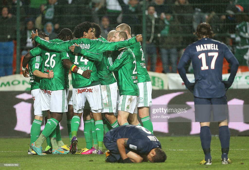 Brandao of Saint-Etienne and teammates celebrate after tying the game while Thiago Silva of PSG lies on the field and Maxwell looks on during the Ligue 1 match between AS Saint-Etienne ASSE and Paris Saint-Germain FC at the Stade Geoffroy-Guichard on March 17, 2013 in Saint-Etienne, France.