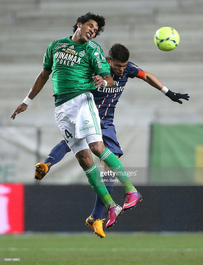 Brandao of Saint-Etienne and Thiago Silva of PSG in action during the Ligue 1 match between AS Saint-Etienne ASSE and Paris Saint-Germain FC at the Stade Geoffroy-Guichard on March 17, 2013 in Saint-Etienne, France.
