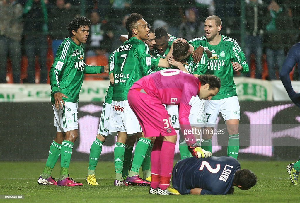 Brandao, Pierre-Emerick Aubameyang and Mathieu Bodmer of Saint-Etienne celebrate after tying the game while Salvatore Sirigu of PSG looks after Thiago Silva lying on the field during the Ligue 1 match between AS Saint-Etienne ASSE and Paris Saint-Germain FC at the Stade Geoffroy-Guichard on March 17, 2013 in Saint-Etienne, France.