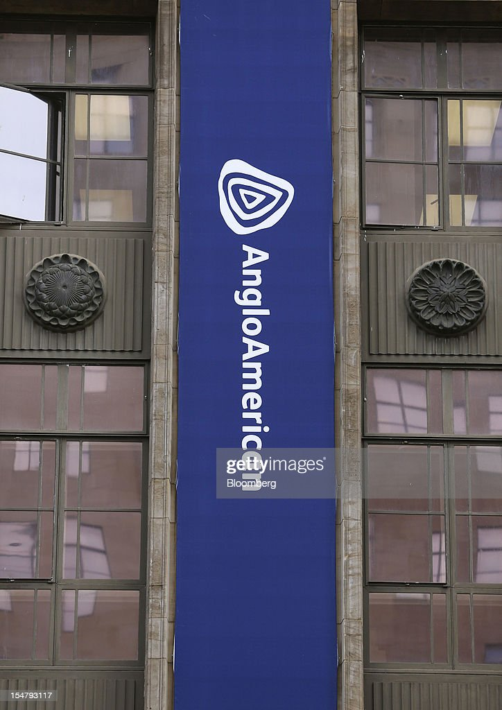 A branded banner hangs from the offices of Anglo American Plc in the Marshalltown district of Johannesburg, South Africa, on Friday, Oct. 26, 2012. Anglo American Plc Chief Executive Officer Cynthia Carroll , the first woman, external hire and non-South African to hold the job, will quit after Anglo lost $14 billion in value in the more than five years she was in charge. Photographer: Chris Ratcliffe/Bloomberg via Getty Images