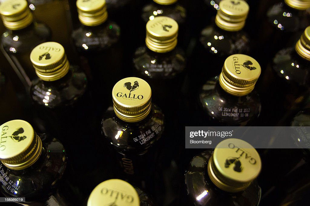 Branded caps are seen on bottles of olive oil at the Gallo Worldwide plant in Abrantes, Portugal, on Friday, Dec. 14, 2012. The Iberian nation has already been granted more time to narrow its budget shortfall after tax increases failed to bring in enough money to meet forecasts as the economy heads for a third year of contraction in 2013. Photographer: Mario Proenca/Bloomberg via Getty Images