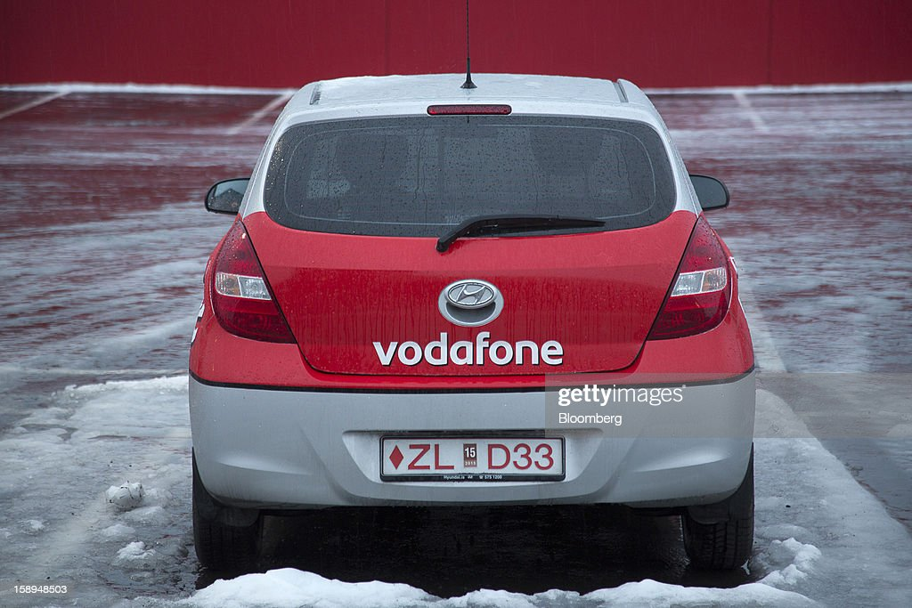 A branded company vehicle stands in a parking lot outside the offices of Vodafone Iceland Fjarskipti hf in Reykjavik, Iceland, on Wednesday, Jan. 2, 2013. Creditors of Iceland's three biggest failed banks are fighting for a waiver to krona controls imposed in 2008 amid risks pay-outs will be delayed beyond 2015. Photographer: Arnaldur Halldorsson/Bloomberg via Getty Images