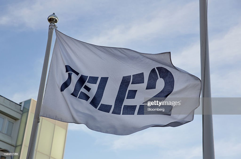 A branded flag flies outside the headquarters of Tele2 AB in Stockholm, Sweden, on Friday, Jan. 4, 2013. OAO Rostelecom's largest owner after the Russian state, Konstantin Malofeev, is urging the country's dominant fixed-line operator to buy the local unit of Sweden's Tele2 AB to form a fourth nationwide wireless carrier. Photographer: Casper Hedberg/Bloomberg via Getty Images