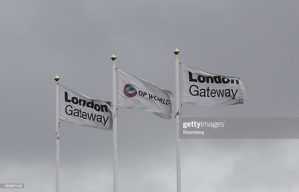 Branded flags fly at the entrance to the new DP World Ltd. London Gateway shipping terminal in Stanford-le-Hope, U.K., on Friday, March 1, 2013. DP World, which operates more than 60 terminals in six continents, said it is on track to open new capacity in Santos in Brazil, Jebel Ali in the United Arab Emirates and London Gateway in the U.K. this year. Photographer: Chris Ratcliffe/Bloomberg via Getty Images