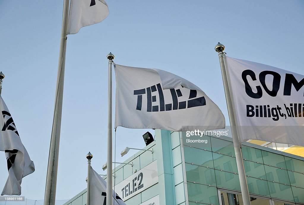 Branded flags fly outside the headquarters of Tele2 AB in Stockholm, Sweden, on Friday, Jan. 4, 2013. OAO Rostelecom's largest owner after the Russian state, Konstantin Malofeev, is urging the country's dominant fixed-line operator to buy the local unit of Sweden's Tele2 AB to form a fourth nationwide wireless carrier. Photographer: Casper Hedberg/Bloomberg via Getty Images