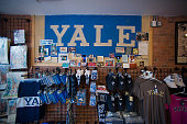 Branded items are displayed for sale at the Campus Customs store near the Yale University campus in New Haven Connecticut US on Friday June 12 2015...