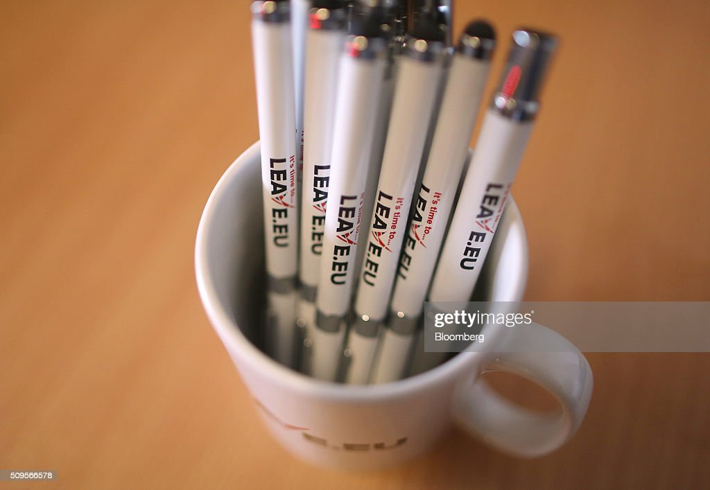 Branded pens sit inside a promotional mug inside the Leave.EU campaign headquarters, a party campaigning against Britain's membership of the European Union, in London, U.K., on Thursday, Feb. 11, 2016. Britain's economy could be thrown off track by the planned referendum on European Union membership, according to the Confederation for British Industry. Photographer: Chris Ratcliffe/Bloomberg via Getty Images