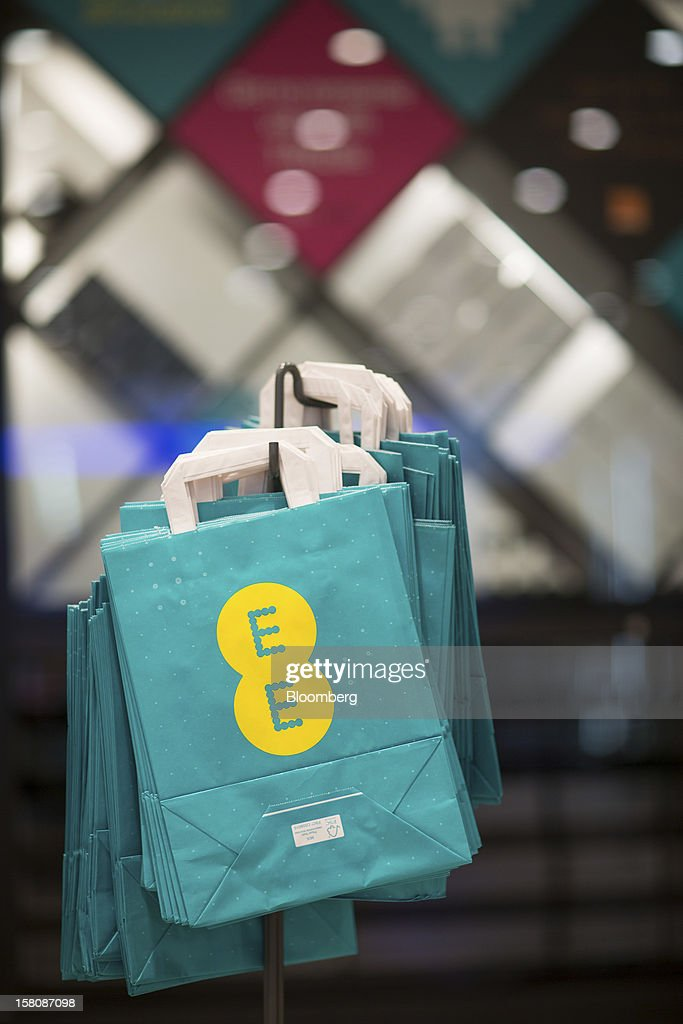Branded shopping bags hang on display ahead of use inside a EE (Everything Everywhere) store, a joint venture between France Telecom SA and Deutsche Telekom AG, in Stratford, U.K., on Monday, Dec. 5, 2012. France Telecom CEO Stephane Richard said in an interview last month that the Paris-based company has received interest from private-equity firms seeking a minority stake in the 50-50 venture, and may also consider an initial public offering of the unit. Photographer: Jason Alden/Bloomberg via Getty Images