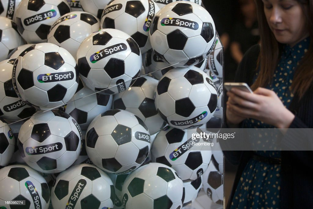 Branded soccer balls sit on display during the launch of BT Group Plc's new sports television channel BT Sport, at the company's offices in London, U.K., on Thursday, May 9, 2013. British Sky Broadcasting Group Plc, the U.K.'s largest pay-TV broadcaster, fell the most in almost a year after BT Group Plc unveiled sports channels to compete with the Rupert Murdoch-controlled satellite operator. Photographer: Simon Dawson/Bloomberg via Getty Images