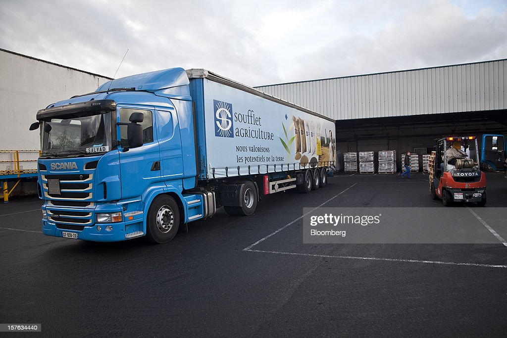 A branded truck loaded with cereal grain leaves the loading depot at the Groupe Soufflet plant in Nogent-sur-Seine, France, on Tuesday, Dec. 4, 2012. European Union corn imports may be the second-highest on record this season after drought parched crops and a surge in wheat exports curbed domestic grain supply. Photographer: Balint Porneczi/Bloomberg via Getty Images