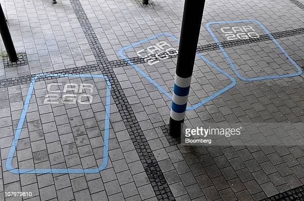 Branded vehicle parking bays for Daimler AG's Car2go rental service are seen in a car park in Ulm Germany on Monday Jan 10 2011 Daimler's Car2go...