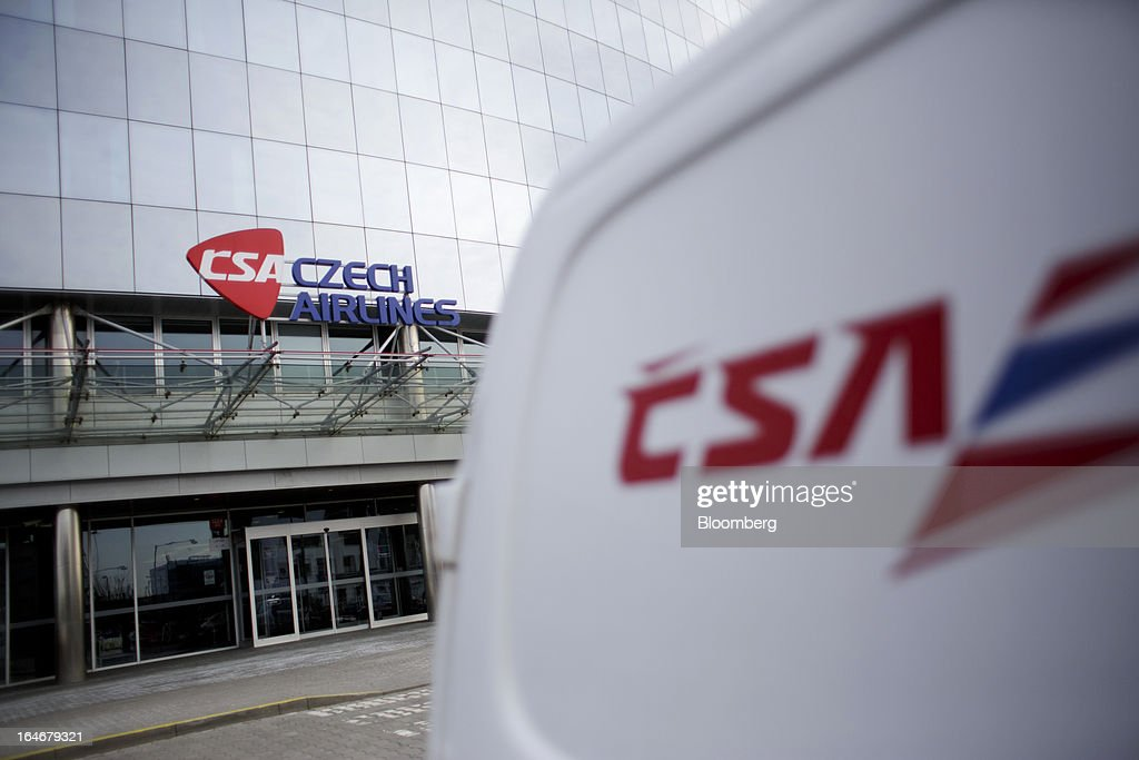 A branded vehicle stands outside the entrance to the head office of Ceske Aerolinie AS (CSA) airlines in Prague, Czech Republic, on Monday, March 25, 2013. Korean Air Lines Co. pledged to hold its stake in Ceske Aerolinie AS for five years, while CSA's majority owner will refrain from making 'significant' changes in its strategy, according to terms of this week's sale. Photographer: Martin Divisek/Bloomberg via Getty Images
