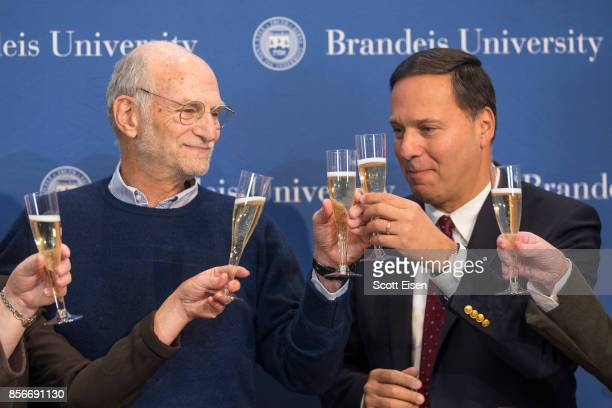 Brandeis Professor Michael Rosbash shares a champagne toast with Brandeis University President Ron Liebowitz following a press conference after it...