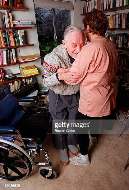 Brandeis Professor Morris Schwartz has Lou Gehrig's Disease Connie Luongo helps him get into his wheelchair