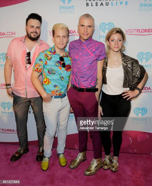 Branden Campbell Chris Allen Tyler Glenn and Elaine Bradley of the music group 'Neon Trees' attends iHeartRadio Ultimate Pool Party presented by...