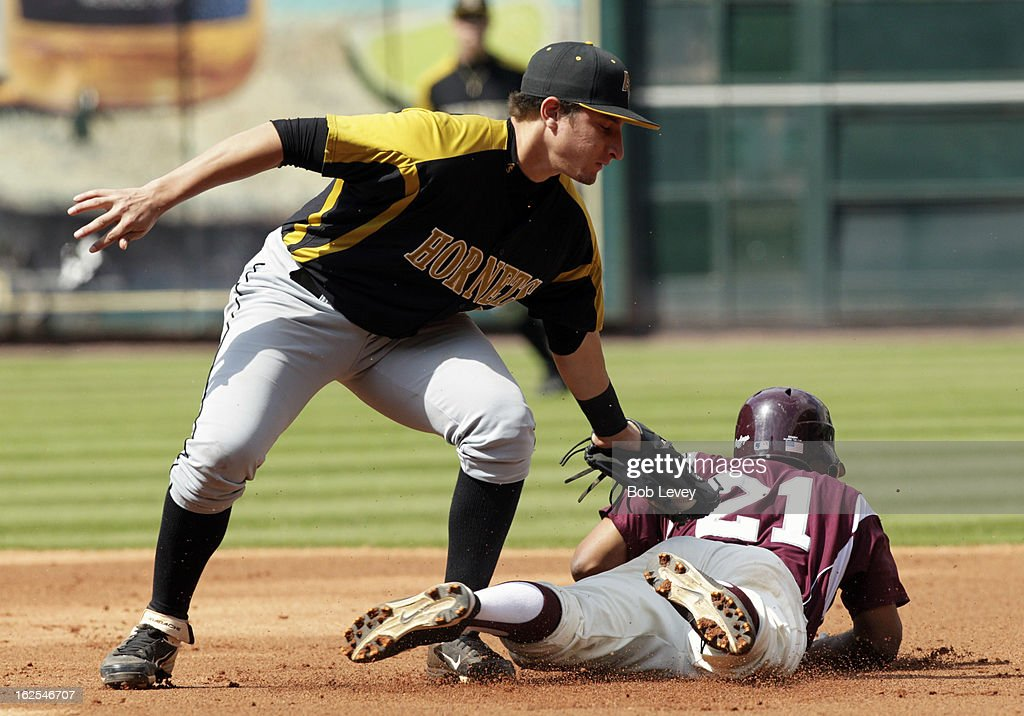 Branden Castro #21 of Alabama State tags out Corbin Smith #21 of TSU during the 2013 Urban Invitational, February 24, 2013 in Houston, Texas.