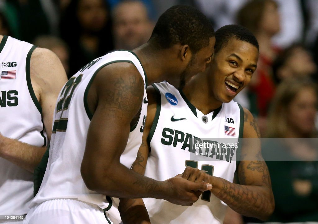 Branden Dawson #22 and Keith Appling #11 of the Michigan State Spartans celebrate late in the game against the Memphis Tigers during the third round of the 2013 NCAA Men's Basketball Tournament at The Palace of Auburn Hills on March 23, 2013 in Auburn Hills, Michigan. Michigan State Spartans won 70-48.