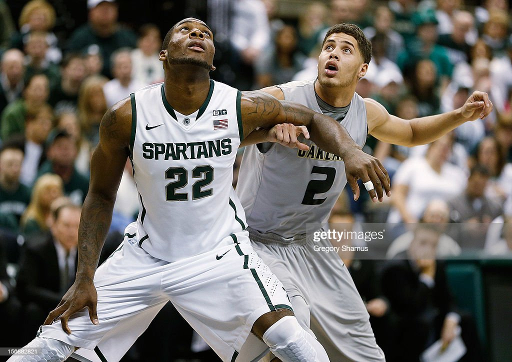 Branden Dawson #22 of the Michigan State Spartans blocks out Dante Williams #2 of the Oakland Golden Grizzlies during a first half free throw at the Jack T. Breslin Students Events Center on November 23, 2012 in East Lansing, Michigan.