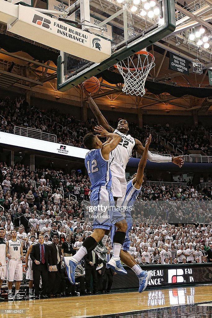 Branden Dawson #22 of the Michigan State Spartans drives the ball over Maodo Lo #12 of the Columbia Lions during the second half of the game at Breslin Center on November 15, 2013 in East Lansing, Michigan. Michigan State defeated Columbia 62-53.