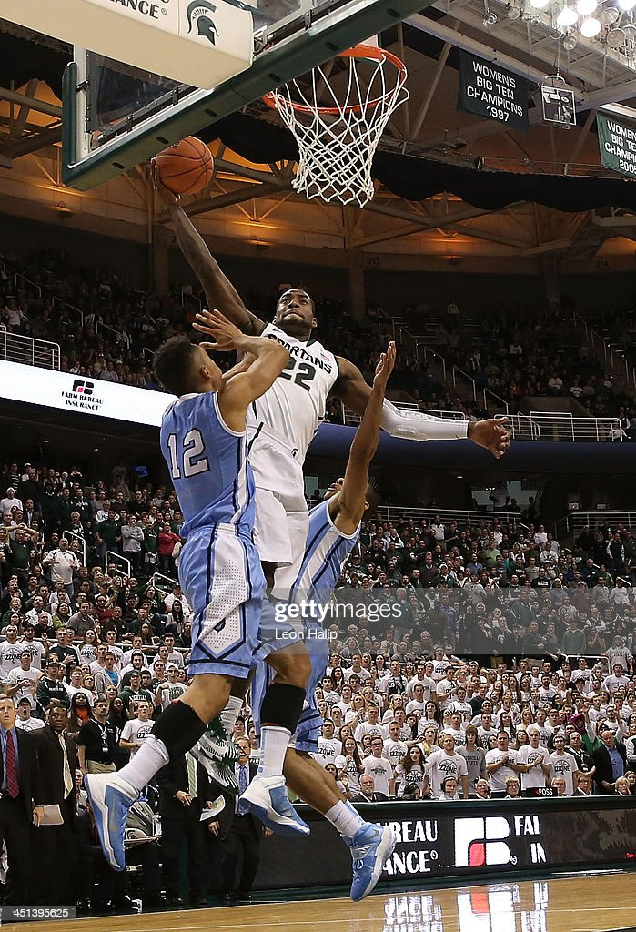 Branden Dawson #22 of the Michigan State Spartans drives the ball to the basket as Maodo Lo #12 of the Columbia Lions during the second half of the game at Breslin Center on November 15, 2013 in East Lansing, Michigan. Michigan State defeated Columbia 62-53.