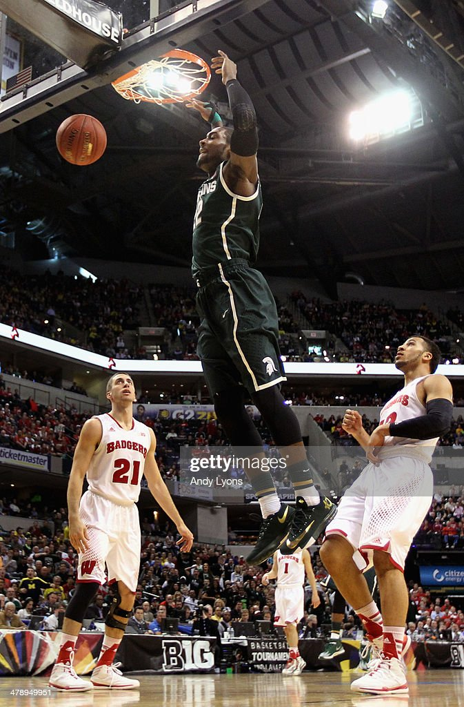 Branden Dawson #22 of the Michigan State Spartans dunks the ball against the Wisconsin Badgers during the first half of the Big Ten Basketball Tournament Semifinal game at Bankers Life Fieldhouse on March 15, 2014 in Indianapolis, Indiana.