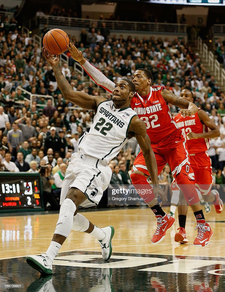 Branden Dawson #22 of the Michigan State Spartans gets caught from behind by Lenzelle Smith, Jr. #32 of the Ohio State Buckeyes at the Jack Breslin Center on January 19, 2013 in East Lansing, Michigan. Michigan State won the game 59-56.