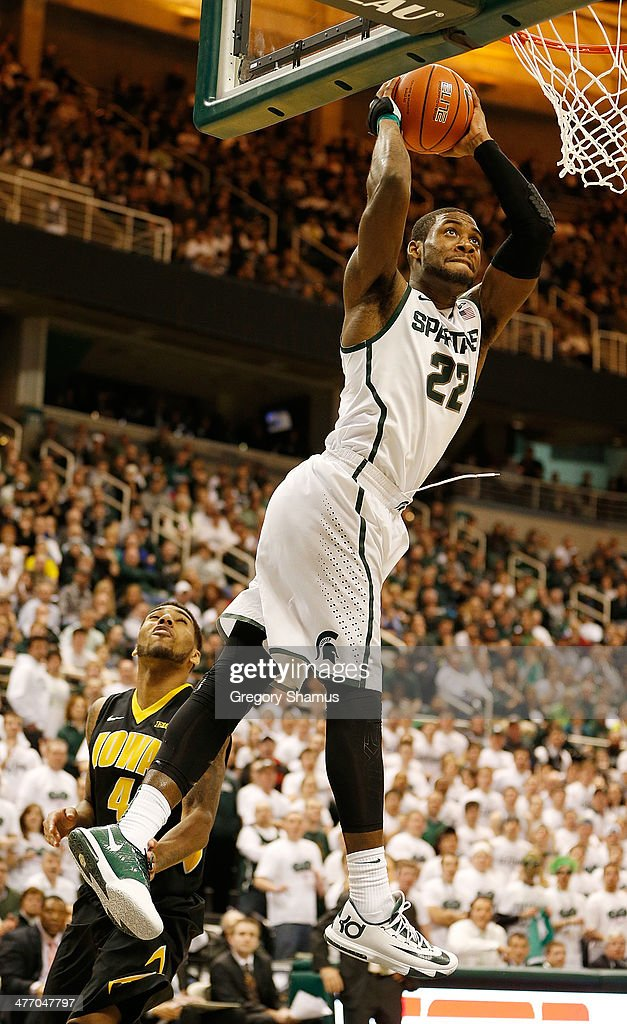 Branden Dawson #22 of the Michigan State Spartans gets in for a second half dunk in front of Roy Devyn Marble #4 of the Iowa Hawkeyes at the Jack T. Breslin Student Events Center on February 6, 2014 in East Lansing, Michigan. Michigan State won the game 86-76.