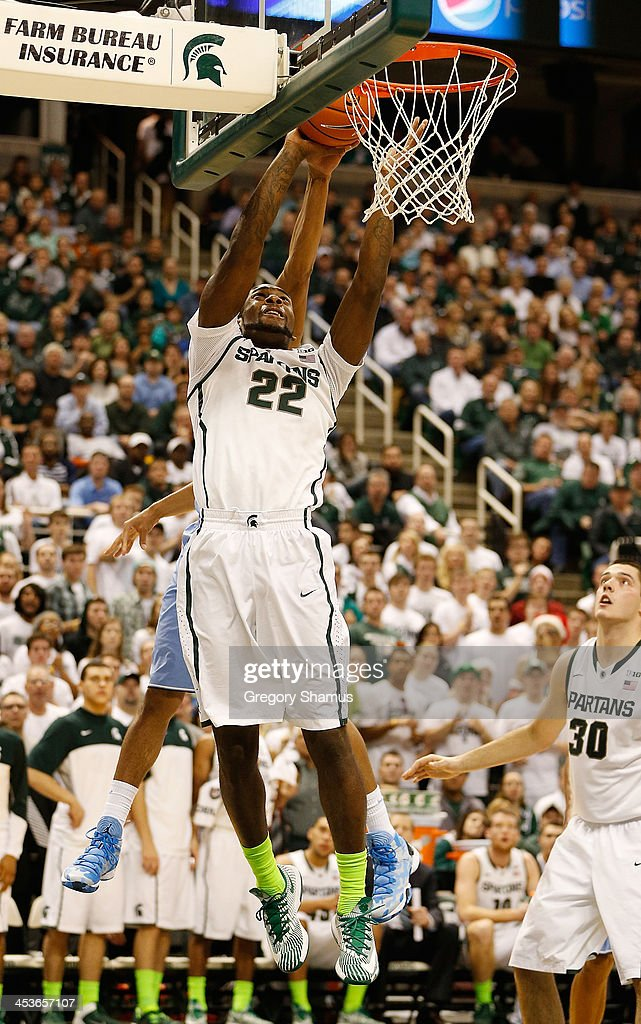 Branden Dawson #22 of the Michigan State Spartans gets to the basket during the second half while playing the North Carolina Tar Heels at the Jack T. Breslin Student Events Center on December 4, 2013 in East Lansing, Michigan. North Carolina won the game 79-65.