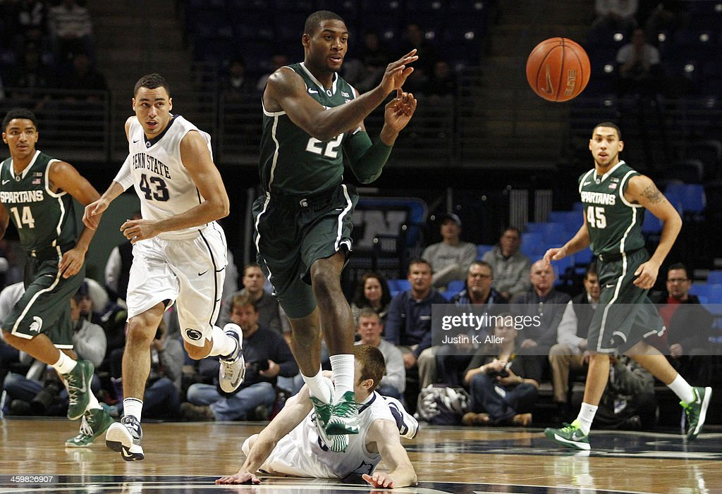 Branden Dawson #22 of the Michigan State Spartans makes a pass against the Penn State Nittany Lions at the Bryce Jordan Center on December 31, 2013 in State College, Pennsylvania.