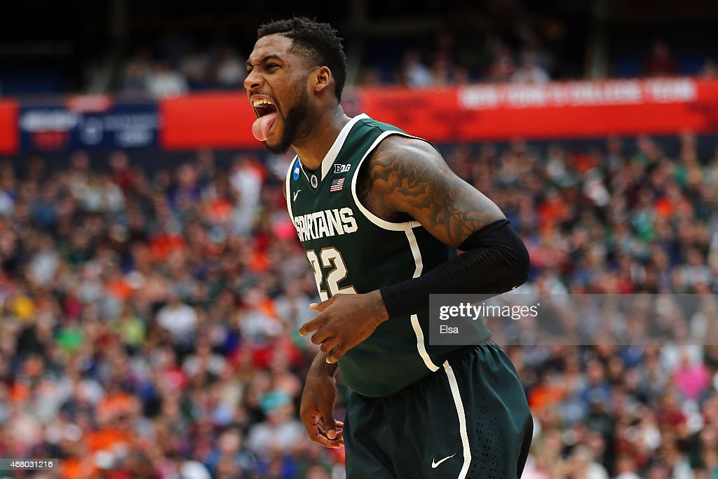 <a gi-track='captionPersonalityLinkClicked' href=/galleries/search?phrase=Branden+Dawson&family=editorial&specificpeople=7621225 ng-click='$event.stopPropagation()'>Branden Dawson</a> #22 of the Michigan State Spartans reacts after a basket in the first half of the game against the Louisville Cardinals during the East Regional Final of the 2015 NCAA Men's Basketball Tournament at Carrier Dome on March 29, 2015 in Syracuse, New York.