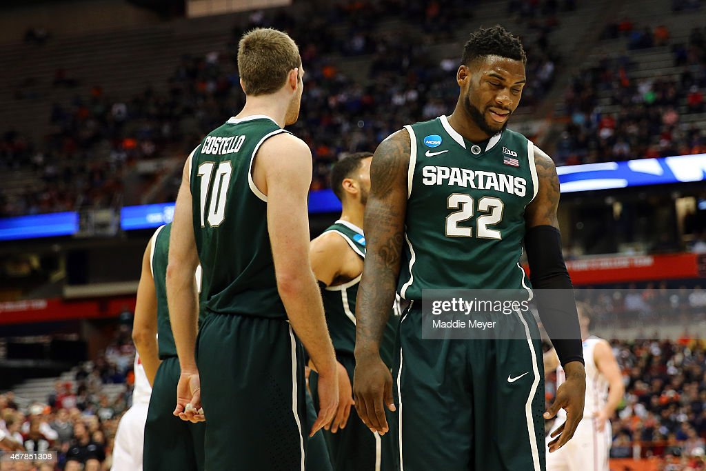 <a gi-track='captionPersonalityLinkClicked' href=/galleries/search?phrase=Branden+Dawson&family=editorial&specificpeople=7621225 ng-click='$event.stopPropagation()'>Branden Dawson</a> #22 of the Michigan State Spartans reacts with teammates in the first half of the game against the Oklahoma Sooners during the East Regional Semifinal of the 2015 NCAA Men's Basketball Tournament at the Carrier Dome on March 27, 2015 in Syracuse, New York.