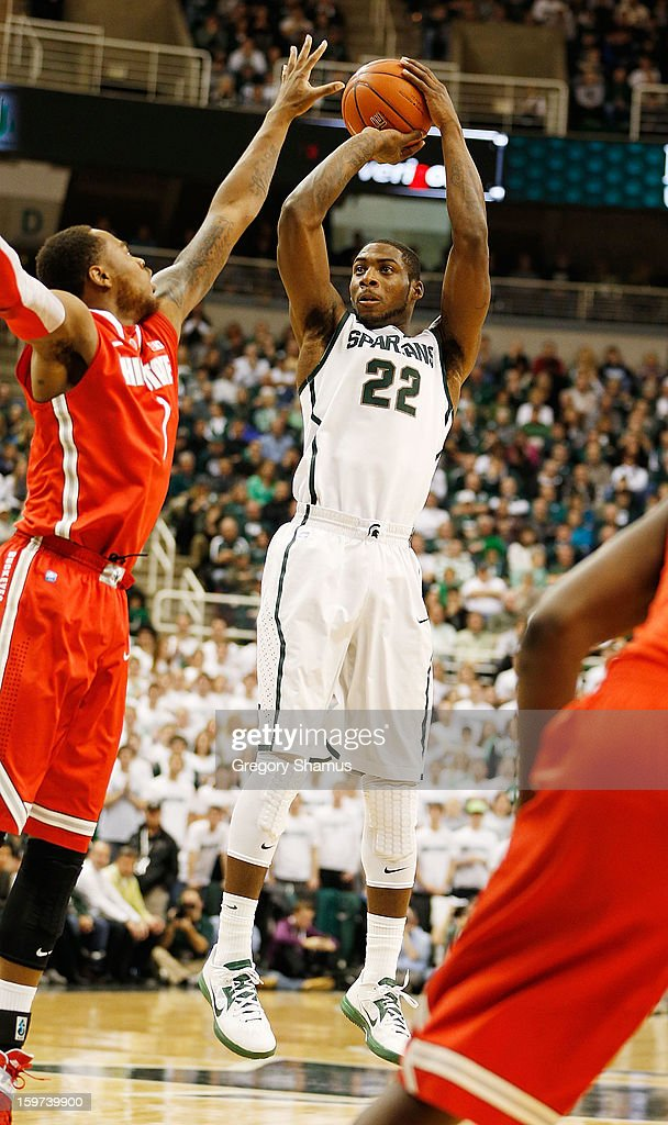 Branden Dawson #22 of the Michigan State Spartans shoots against Deshaun Thomas #1 of the Ohio State Buckeyes in the first half at the Jack Breslin Center on January 19, 2013 in East Lansing, Michigan. Michigan State won the game 59-56.