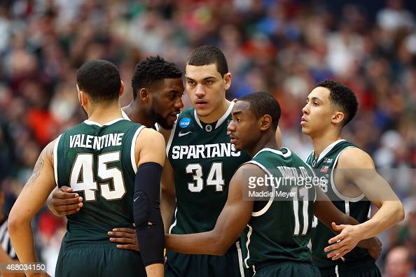 Branden Dawson of the Michigan State Spartans talks with his teammates in a huddle against the Louisville Cardinals during the East Regional Final of...