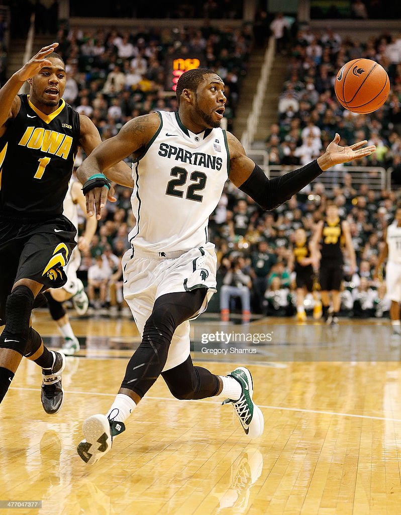 Branden Dawson #22 of the Michigan State Spartans tries to control the ball next to Melsahn Basabe #1 of the Iowa Hawkeyes during the second half at the Jack T. Breslin Student Events Center on February 6, 2014 in East Lansing, Michigan. Michigan State won the game 86-76.