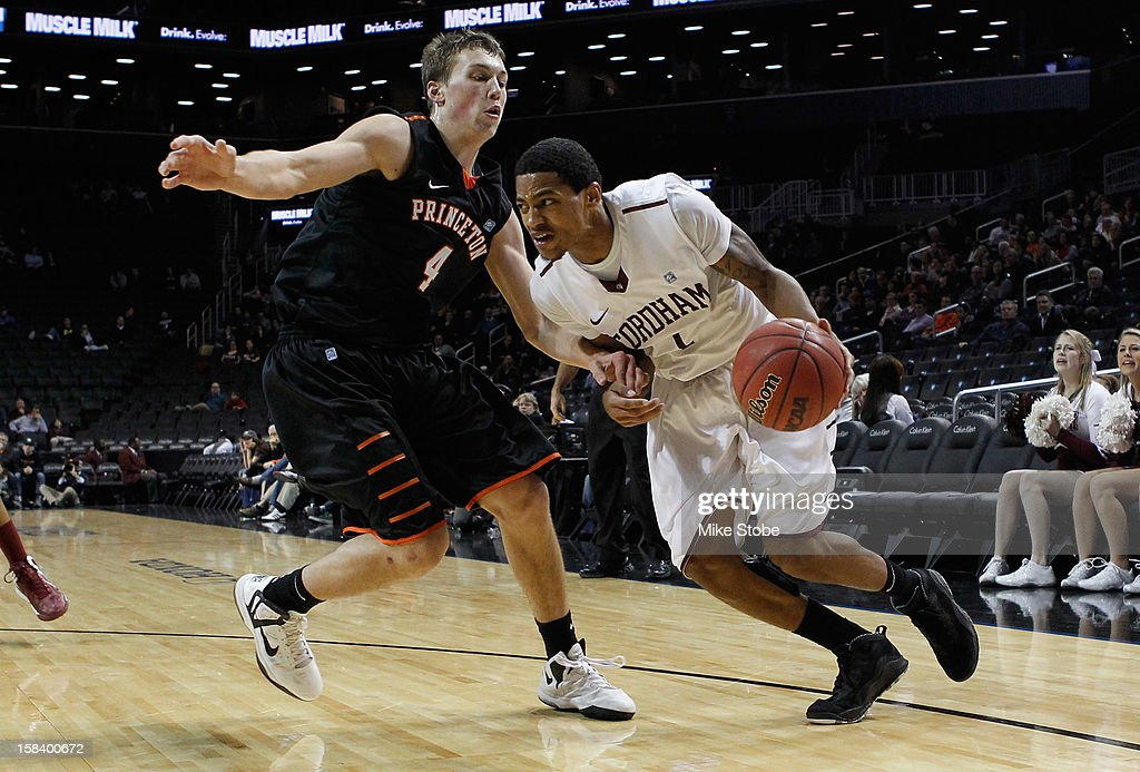 Branden Frazier #1 of the Fordham Rams drives to the net against Denton Koon #4 of the Princeton Tigers during the Brooklyn Hoops Winter Festival at Barclays Center on December 15, 2012 in the Brooklyn borough of New York City. Fordham Rams defeated Princeton Tigers 63-60.