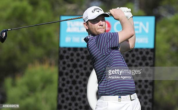 Branden Grace of England plays a shot during the 4th day of the Turkish Airlines Open 2014 at the Montgomerie Maxx Royal on November 16 2014 in...