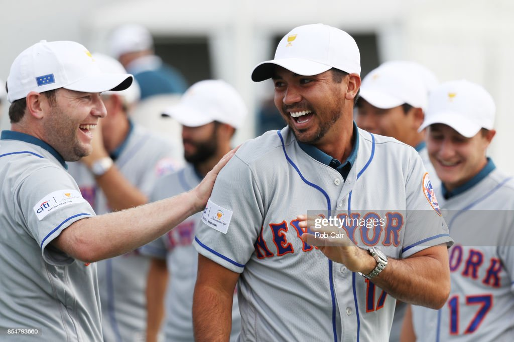 Branden Grace of South Africa and the International Team and Jason Day of Australia and the International Team laugh prior practice rounds prior to the Presidents Cup at Liberty National Golf Club on September 27, 2017 in Jersey City, New Jersey.