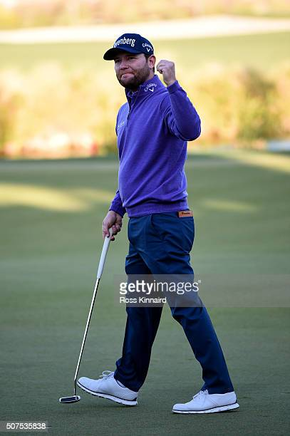 Branden Grace of South Africa celebrate victory on the 18th during the final round of the Commercial Bank Qatar Masters at the Doha Golf Club on...
