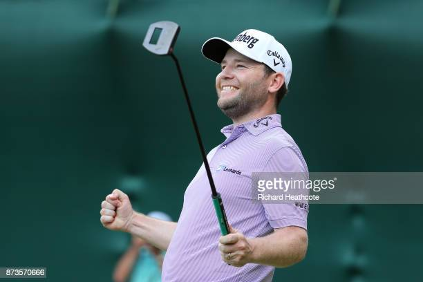 Branden Grace of South Africa celebrates as he holes the winning putt to secure victory during the final round of the 2017 Nedbank Golf Challenge at...