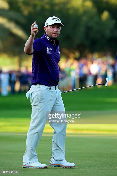 Branden Grace of South Africa celebrates his birdie on the eighteenth green during the final round of the Commercial Bank Qatar Masters at Doha Golf...