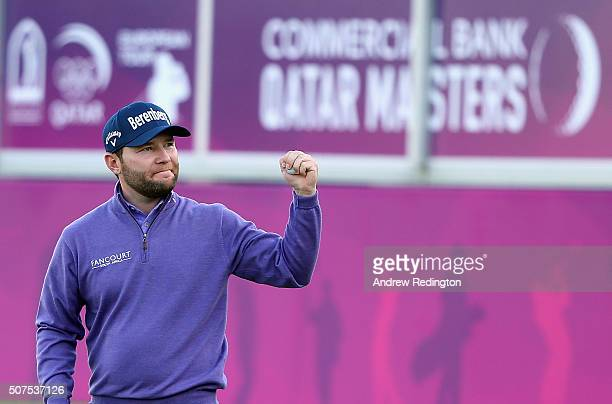 Branden Grace of South Africa celebrates on the 18th green after winning the Commercial Bank Qatar Masters at Doha Golf Club on January 30 2016 in...