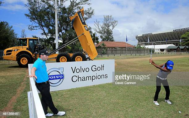 Branden Grace of South Africa conducts a Junior Clinic on the driving range during the proam as a preview for the 2014 Volvo Golf Champions...