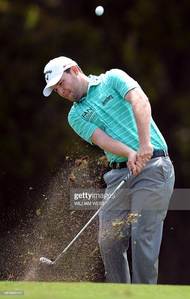 Branden Grace of South Africa hits a shot during the Golf World Cup tournament at the Royal Melbourne course in Melbourne on November 21, 2013. AFP PHOTO/William WEST USE