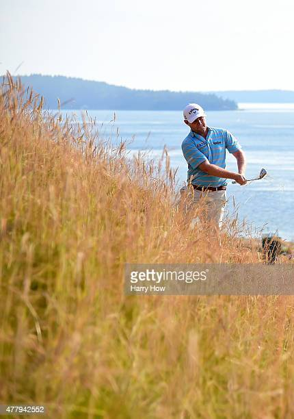Branden Grace of South Africa hits his second shot on the 12th hole during the third round of the 115th US Open Championship at Chambers Bay on June...
