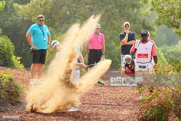 Branden Grace of South Africa hits his second shot on the 3rd hole during day four of the DP World Tour Championship at Jumeirah Golf Estates on...