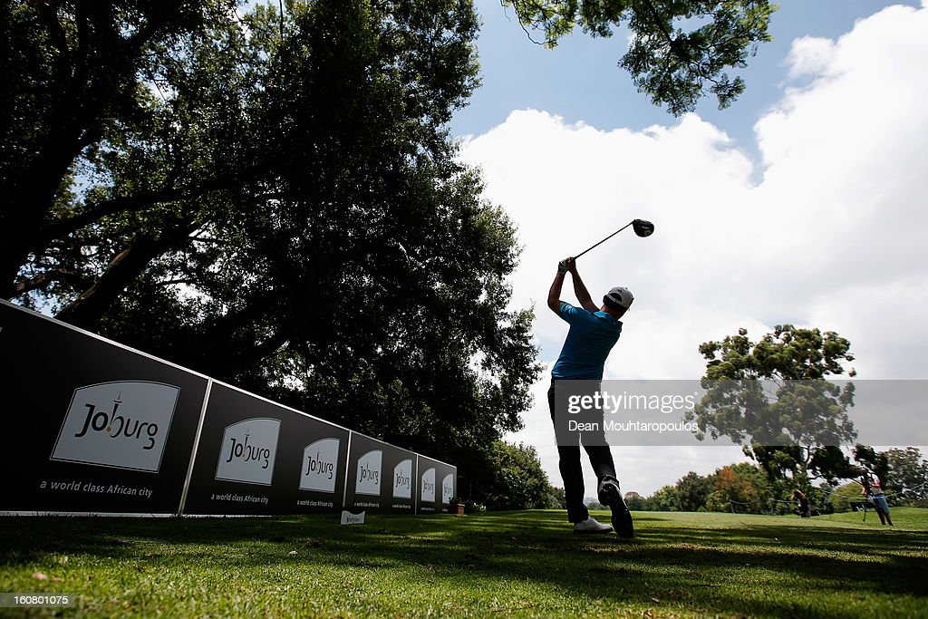 <a gi-track='captionPersonalityLinkClicked' href=/galleries/search?phrase=Branden+Grace+-+Golfer&family=editorial&specificpeople=4816558 ng-click='$event.stopPropagation()'>Branden Grace</a> of South Africa hits his tee shot on the 10th East Course tee during the Joburg Open ProAm at Royal Johannesburg and Kensington Golf Club on February 6, 2013 in Johannesburg, South Africa.