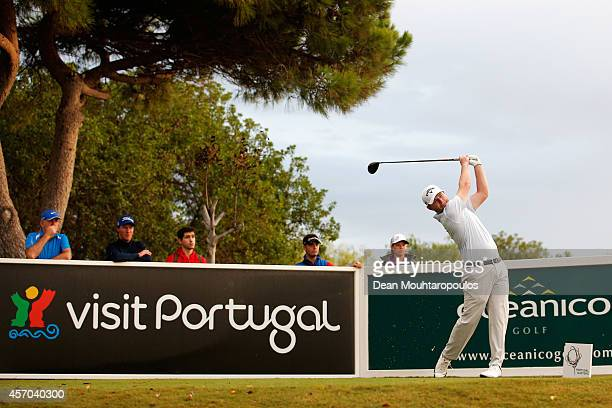 Branden Grace of South Africa hits his tee shot on the 9th hole during Day 3 of the Portugal Masters held at the Oceanico Victoria Golf Course on...