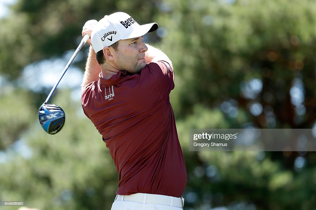 <a gi-track='captionPersonalityLinkClicked' href=/galleries/search?phrase=Branden+Grace+-+Golfer&family=editorial&specificpeople=4816558 ng-click='$event.stopPropagation()'>Branden Grace</a> of South Africa hits off the 18th tee during the first round of the World Golf Championships - Bridgestone Invitational at Firestone Country Club South Course on June 30, 2016 in Akron, Ohio.